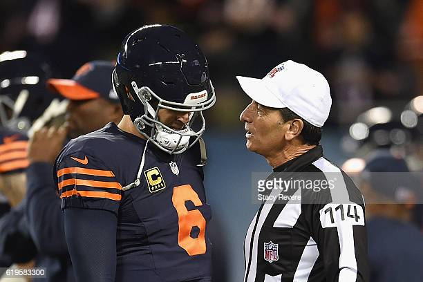 Jay Cutler of the Chicago Bears talks with referee Gene Steratore before the game against the Minnesota Vikings at Soldier Field on October 31, 2016...