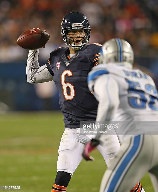 Jay Cutler of the Chicago Bears throws a touchdown pass under pressure from Justin Durant of the Detroit Lions at Soldier Field on October 22, 2012...