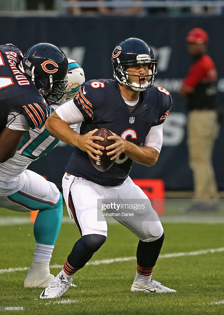 Jay Cutler #6 of the Chicago Bears tries to avoid the rush against the Miami Dolphins during a preseason game at Soldier Field on August 13, 2015 in Chicago, Illinois.