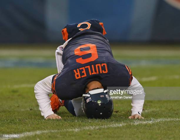 Jay Cutler of the Chicago Bears tries to get up after being sacked during a game against the Green Bay Packers at Soldier Field on December 16, 2012...