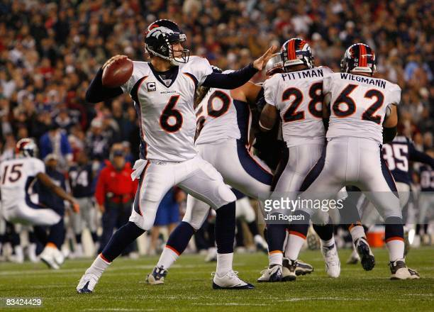 Jay Cutler of the Denver Broncos throws a pass against the New england Patriots at Gillette Stadium on October 20 2008 in Foxboro Massachusetts The...