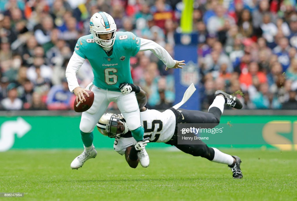 Jay Cutler #6 of the Miami Dolphins is tackled by Rafael Bush #25 of the New Orleans Saints in the first half during the NFL game between the Miami Dolphins and the New Orleans Saints at Wembley Stadium on October 1, 2017 in London, England.