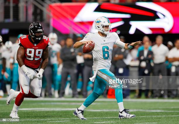 Jay Cutler of the Miami Dolphins rushes through the prior to passing for a touchdown against the Atlanta Falcons at MercedesBenz Stadium on October...