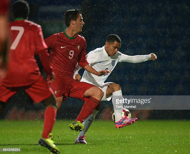 Jay Da Silva of England is tackled by Marcelo of Portugal during the Under 17 International match between England U17 and Portugal U17 at Proact...