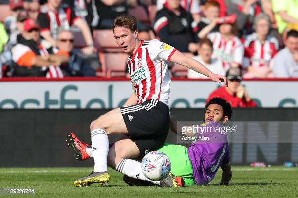Jay DaSilva of Bristol City tackles Kieran Dowell of Sheffield United at Bramall Lane during the Sky Bet Championship match between Sheffield United...