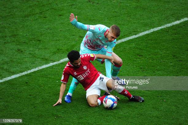 Jay Dasilva of Bristol City vies for possession with Jay Fulton of Swansea City during the Sky Bet Championship match between Bristol City and...