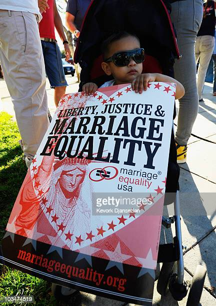 Jay Davis Wasserman holds a protest signs as he participates with his parents Kelly and Candy Wassermans at a samesex marriage advocates...