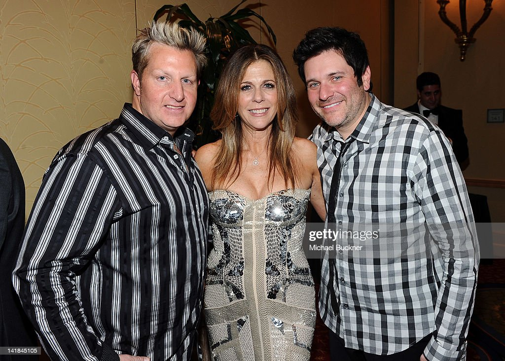 Jay DeMarcus (R) and Gary LeVox (L) of Rascal Flatts pose with actress/singer Rita Wilson at Muhammad Ali's Celebrity Fight Night XVIII held at JW Marriott Desert Ridge Resort & Spa on March 24, 2012 in Phoenix, Arizona.