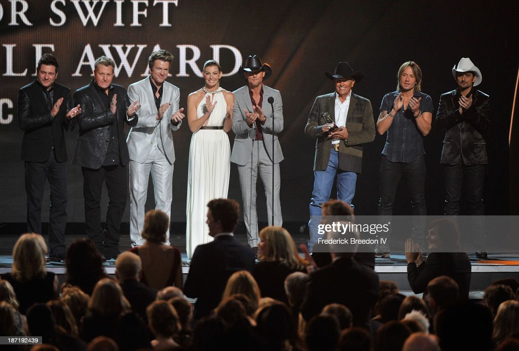 Jay DeMarcus, Gary LeVox and Joe Don Rooney of Rascal Flatts, Faith Hill, Tim McGraw, George Strait, Keith Urban and Brad Paisley on stage during the 47th annual CMA awards at the Bridgestone Arena on November 6, 2013 in Nashville, Tennessee.