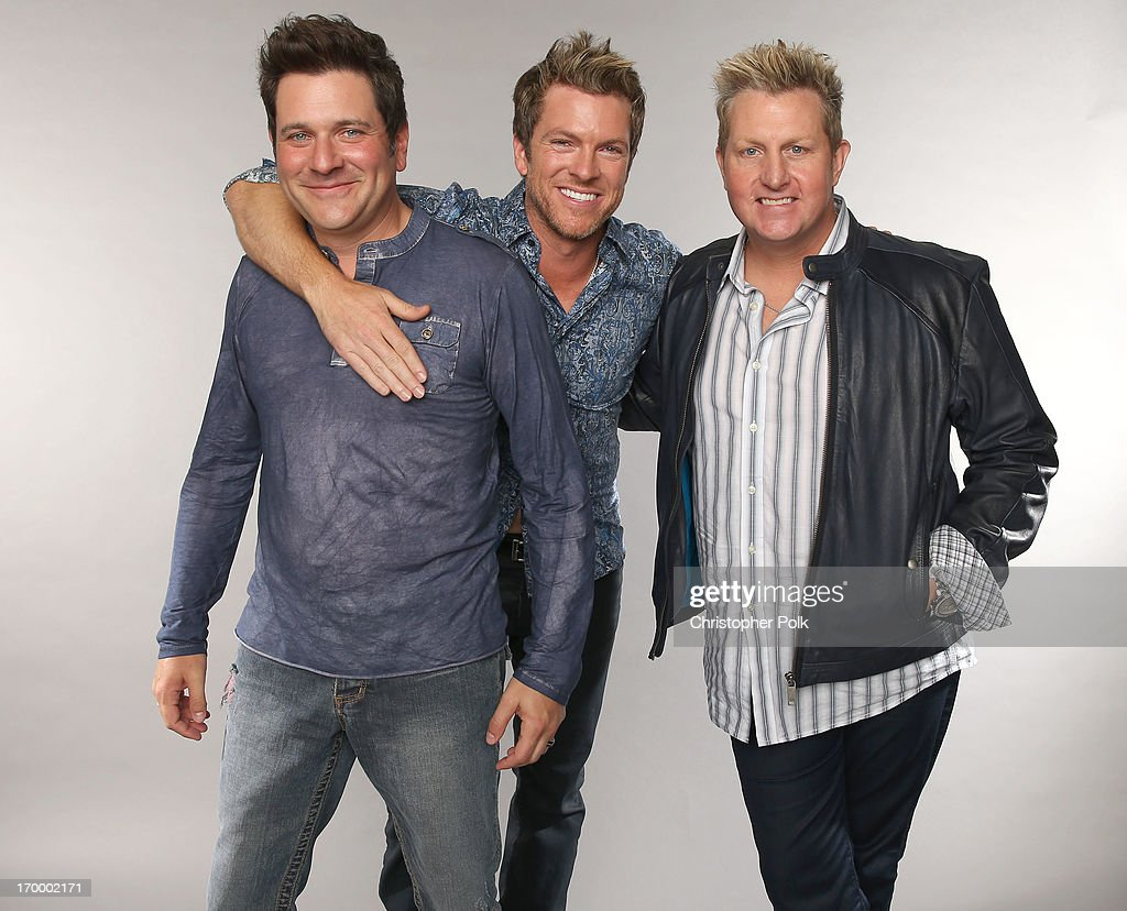 Jay DeMarcus, Joe Don Rooney and Gary LeVox of Rascal Flatts pose at the Wonderwall portrait studio during the 2013 CMT Music Awards at Bridgestone Arena on June 5, 2013 in Nashville, Tennessee.