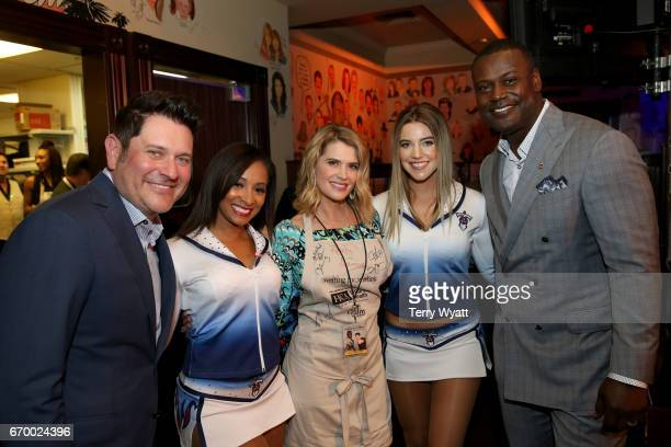 Jay DeMarcus, Kristy Swanson, and Kevin Carter pose with Tennessee Titans Cheerleaders during the 16th Annual Waiting for Wishes Celebrity Dinner...