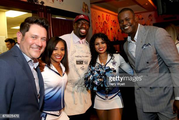 Jay DeMarcus Titus O'Neil and Kevin Carter pose with Tennessee Titans Cheerleaders during the 16th Annual Waiting for Wishes Celebrity Dinner Hosted...