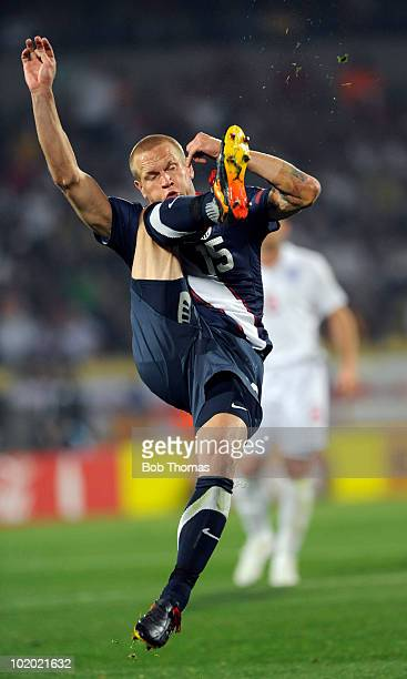 Jay DeMerit of the USA kicks during the 2010 FIFA World Cup South Africa Group C match between England and USA at the Royal Bafokeng Stadium on June...