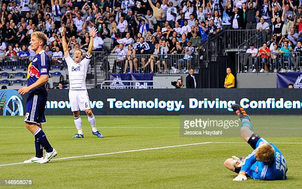 Jay DeMerit of the Vancouver Whitecaps celebrates a goal after the ball got past net minder Ryan Meara of the New York Red Bulls while teammate Jan...