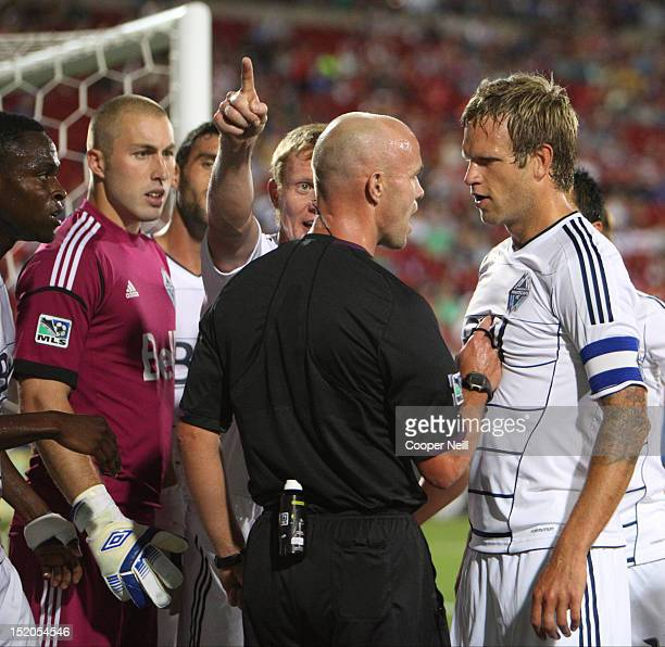 Jay DeMerit of the Vancouver Whitecaps FC argues with an official over a penalty call against the FC Dallas on September 15 2012 at FC Dallas Stadium...