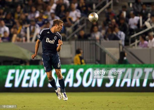 Jay DeMerit of the Vancouver Whitecaps heads the ball clear on defense during the MLS match against the Los Angeles Galaxy at The Home Depot Center...