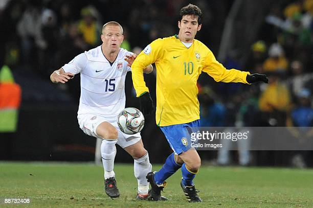 Jay Demerit of USA and Kaka of Brazil compete during the 2009 Confederations Cup final match between Brazil and USA from Ellis Park on June 28 2009...