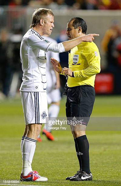 Jay DeMerit of Vancouver Whitecaps argues with official Baldoremo Toledo during a game against Real Salt Lake during the first half of an MLS soccer...