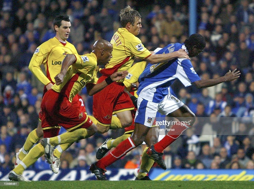 Jay DeMerit of Watford brings down Kanu (R) of Portsmouth inside the box during the Barclays Premiership match between Portsmouth and Watford at Fratton Park on November 18, 2006 in Portsmouth, United Kingdom.