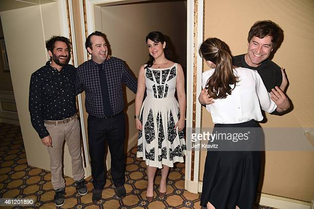 Jay Duplass, writer/director, actor Steve Zississ, actress Melanie Lynskey look on as Mark Duplass, actor/writer/director, hugs actress Amanda Peet...
