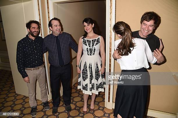 Jay Duplass writer/director actor Steve Zississ actress Melanie Lynskey look on as Mark Duplass actor/writer/director hugs actress Amanda Peet after...