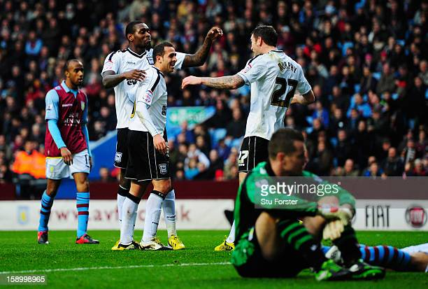 Jay Emmanuel-Thomas, Michael Chopra and Daryl Murphy of Ipswich Town celebrate as Eric Lichaj of Aston Villa scores an own goal as Shay Given of...