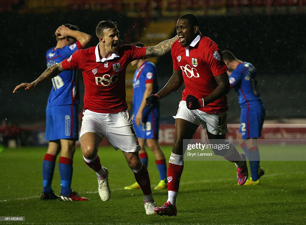 Jay Emmanuel-Thomas (r) of Bristol City celebrates scoring with team mate Aden Flint during the FA Cup Third Round Replay between Bristol City and Doncaster Rovers at Ashton Gate on January 13, 2015 in Bristol, England.