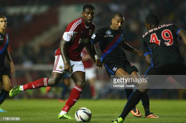 Jay EmmanuelThomas of Bristol City is challenged by Elliot Grandin of Crystal Palace during the Capital One Cup second round match between Bristol...