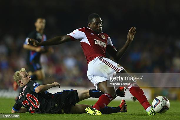 Jay EmmanuelThomas of Bristol City is fouled by Jonathan Williams of Crystal Palace during the Capital One Cup second round match between Bristol...
