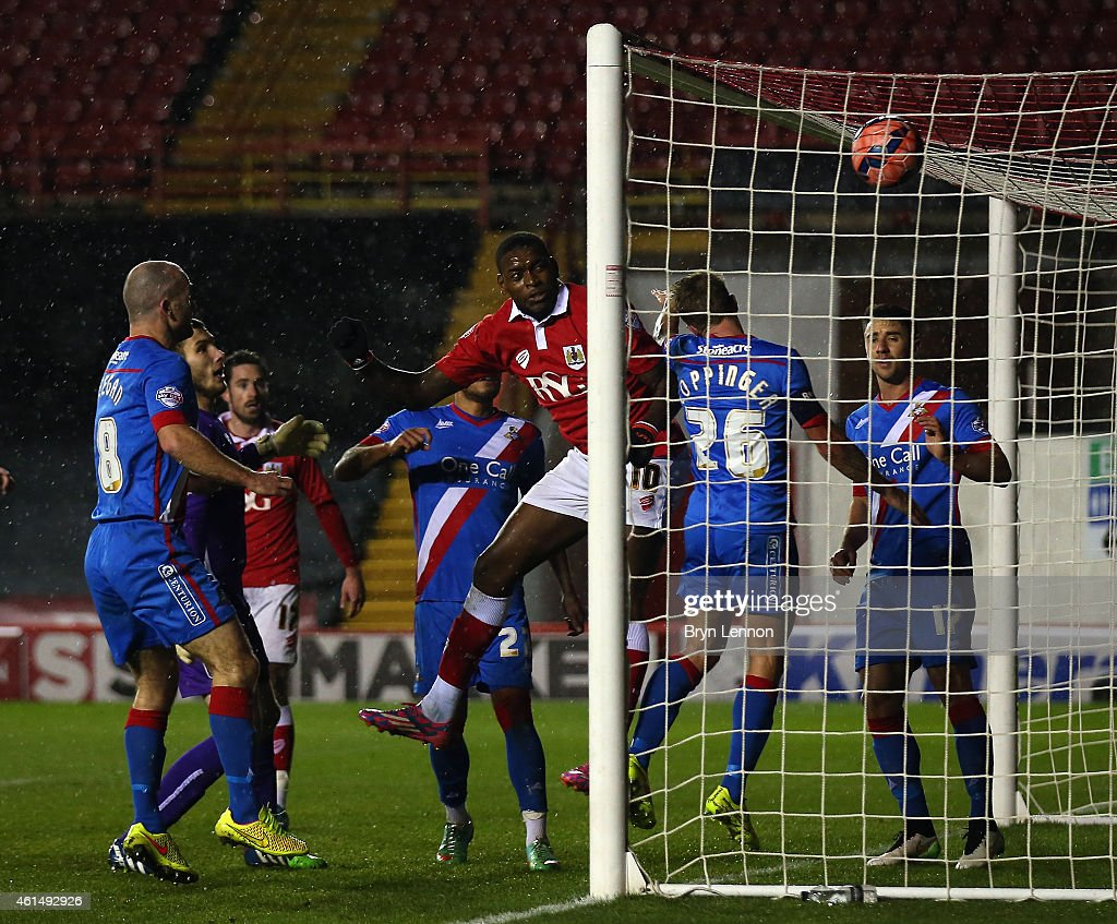 Jay Emmanuel-Thomas (r) of Bristol City scores during the FA Cup Third Round Replay between Bristol City and Doncaster Rovers at Ashton Gate on January 13, 2015 in Bristol, England.