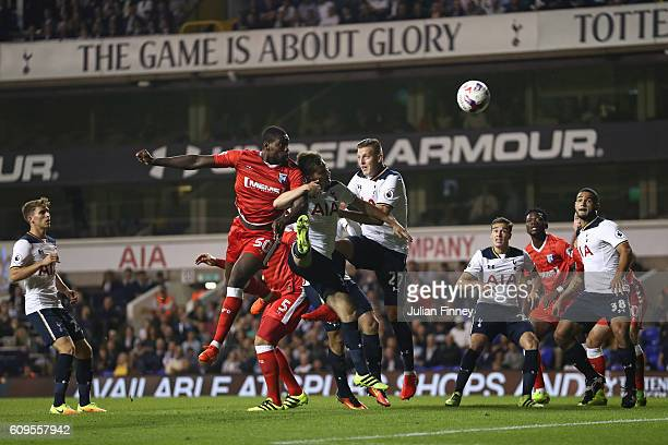 Jay EmmanuelThomas of Gillingham heads on goal during the EFL Cup Third Round match between Tottenham Hotspur and Gillingham at White Hart Lane on...