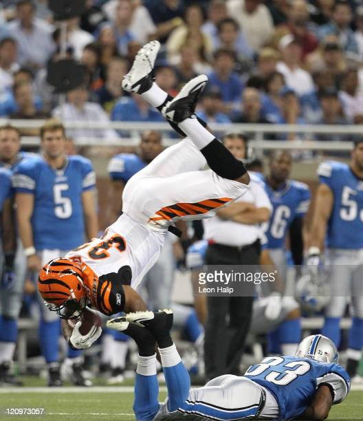 Jay Finely of the Cincinnati Bengals runs for a short gain as Brandon McDonald of the Detroit Lions makes the stop during the second quarter of the...