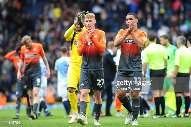 Jay Fulton and Cameron CarterVickers of Swansea City applauds the fans at the final whistle during the Sky Bet Championship match between Blackburn...