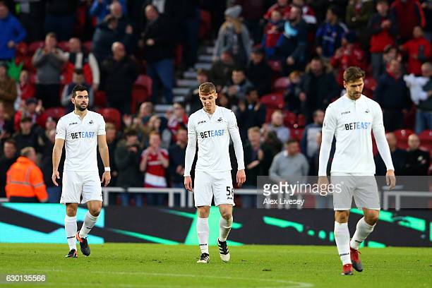 Jay Fulton of Swansea City and his Swansea City team mates are dejected after Middlesbrough score their first goal of the game during the Premier...