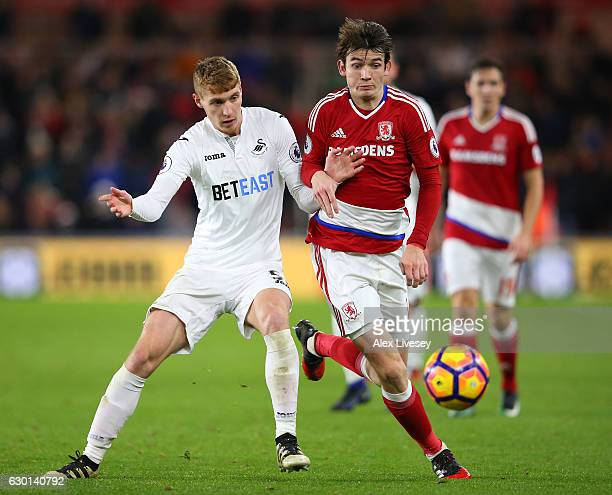 Jay Fulton of Swansea City and Marten de Roon of Middlesbrough battle for possession during the Premier League match between Middlesbrough and...