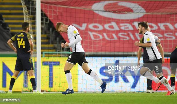 Jay Fulton of Swansea City celebrates after scoring his sides first goal during the Sky Bet Championship match between Swansea City and Stoke City at...