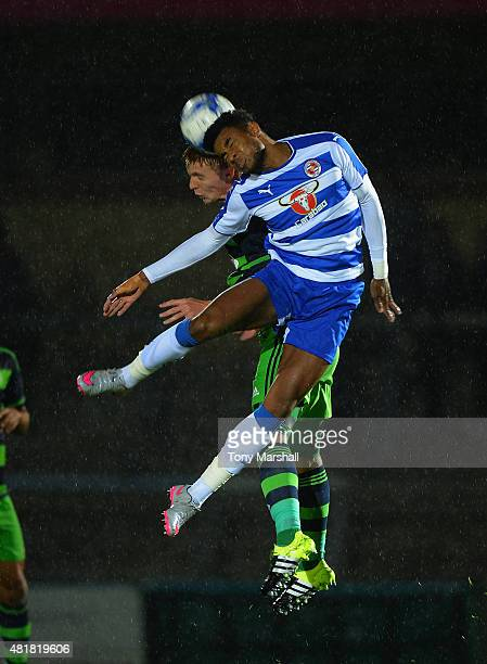 Jay Fulton of Swansea City challenges Dominic Samuel of Reading in the air during the Pre Season Friendly match between Reading and Swansea City at...