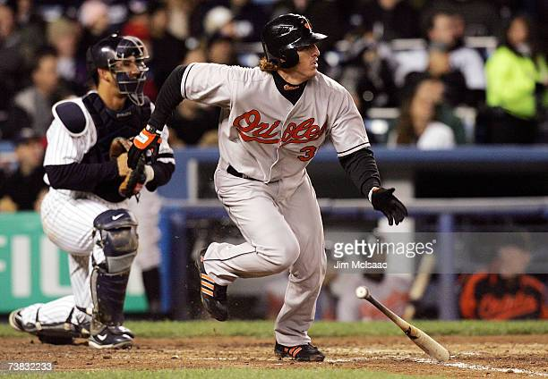 Jay Gibbons of the Baltimore Orioles watches his two run base hit in the third inning against the New York Yankees at Yankee Stadium on April 6, 2006...