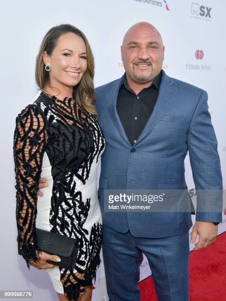 Jay Glazer and guest attend the 33rd Annual CedarsSinai Sports Spectacular at The Compound on July 15 2018 in Inglewood California
