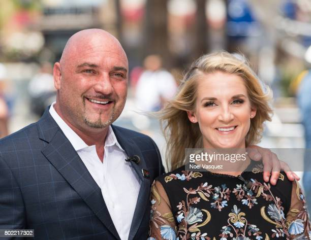 Jay Glazer and Kirstie Ennis visit Extra at Universal Studios Hollywood on June 27 2017 in Universal City California