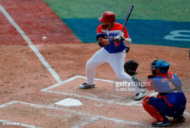 Jay Gonzalez of Puerto Rico's Criollos de Caguas bats against Cuba's Alazanes del Granma during the Caribbean Baseball Series at Charros Jalisco...