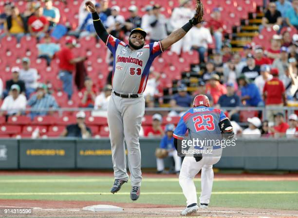Jay Gonzalez of Puerto Rico's Criollos de Caguas tags out at second base Edwin Espinal of the Dominican Republic's Aguilas Cibaenas during the...
