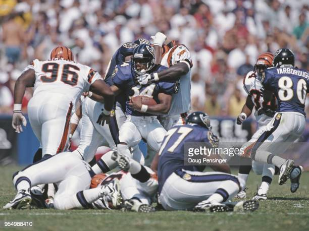Jay Graham Running Back for the Baltimore Ravens is stopped by the Bengals defence during the American Football Conference Central game against the...