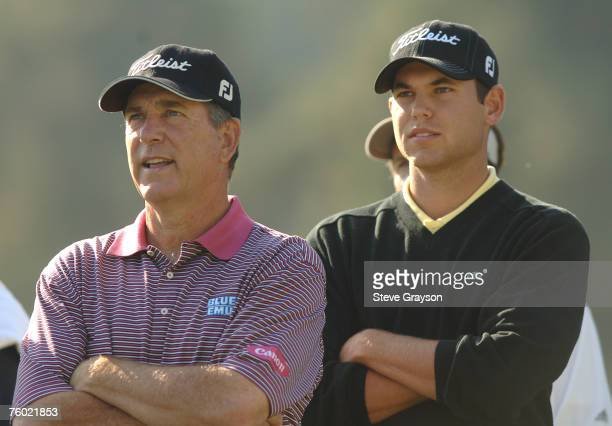 Jay Haas and Bill Haas look on as Brad Faxon hits from the 18th tee during the practice round of the 2006 Nissan Open at Riviera Country Club in...