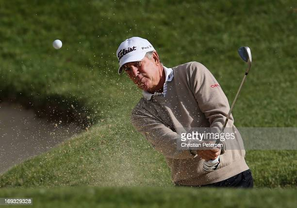 Jay Haas chips from the bunker onto the fourth hole green during Round One of the Senior PGA Championship presented by KitchenAid at Bellerive...