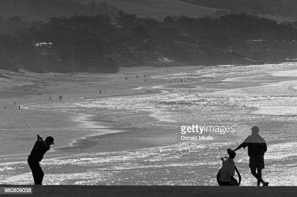 Jay Haas of the United States silhouetted against the oceanside backdrop as he plays from the ninth fairway during the ATT Pebble Beach ProAm golf...