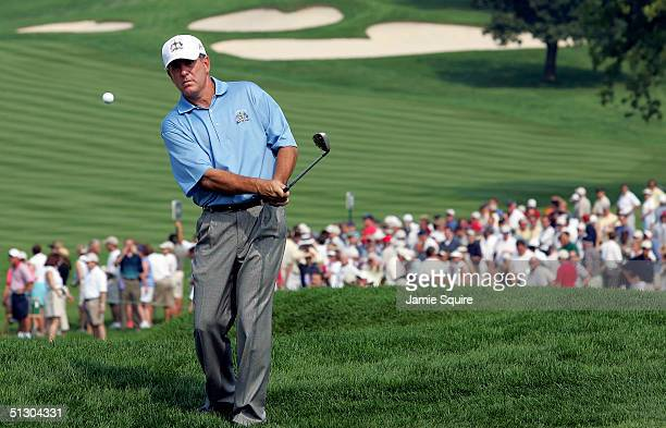 Jay Haas of the USA hits a pitch shot during the first practice day for the 35th Ryder Cup Matches at the Oakland Hills Country Club on September 14...