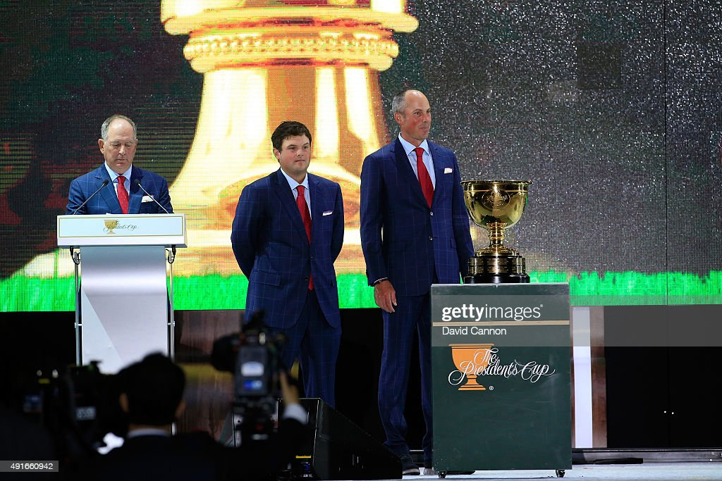Jay Haas the captain of the United States team introduces Matt Kuchar (r) and Patrick Reed (c) of the United States during the opening ceremony of the 2015 Presidents Cup at the Convensia Ceremony Hall on October 7, 2015 in Incheon City, South Korea.