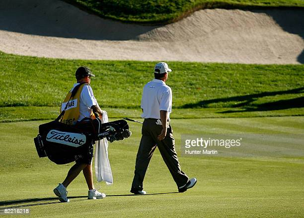 Jay Haas walks down the fairway with his caddie during round two of the 90th PGA Championship at Oakland Hills Country Club on August 8 2008 in...