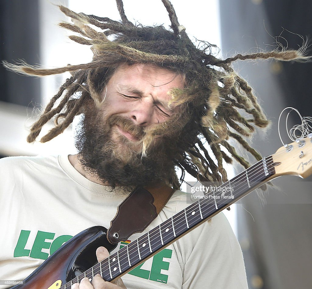 Jay Harris, lead guitarist with Soul Rebel Project, entertains the crowd during the first Reggae Festival at the Maine State Pier in Portland on August 10, 2014.